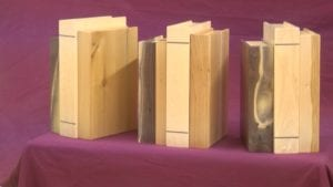 Opheim made these custom order book-like urns for someone's mantle.